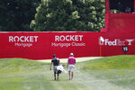 Aaron Baddeley, right, and his caddie walk up to the 15th green during a practice round for the Rocket Mortgage Classic golf tournament, Wednesday, July 1, 2020, at the Detroit Golf Club in Detroit. (AP Photo/Carlos Osorio)