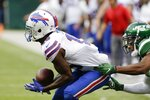 Buffalo Bills' John Brown (15) catches a pass in froint of New York Jets' Darryl Roberts during the second half of an NFL football game Sunday, Sept. 8, 2019, in East Rutherford, N.J. Brown would score a touchdown on the play as the Bills won 17-16. (AP Photo/Seth Wenig)
