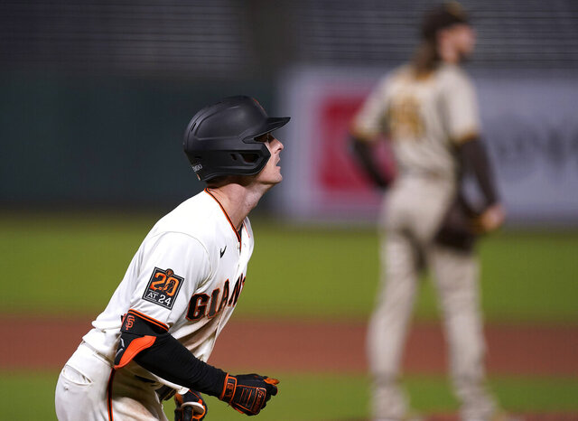 San Francisco Giants' Mike Yastrzemski watches his game-ending solo home run against the San Diego Padres during the ninth inning of a baseball game in San Francisco, Wednesday, July 29, 2020. The Giants won 7-6. (AP Photo/Tony Avelar)