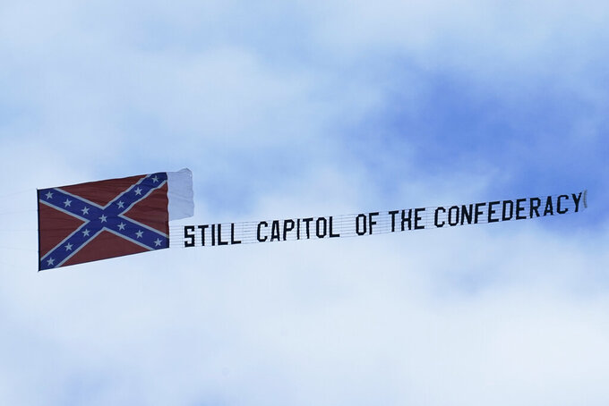 "A small plane carries a banner declaring ""Still Capitol of the Confederacy"" as it flies around  a NASCAR Xfinity Series auto race Saturday, Sept. 12, 2020, in Richmond, Va. (AP Photo/Steve Helber)"
