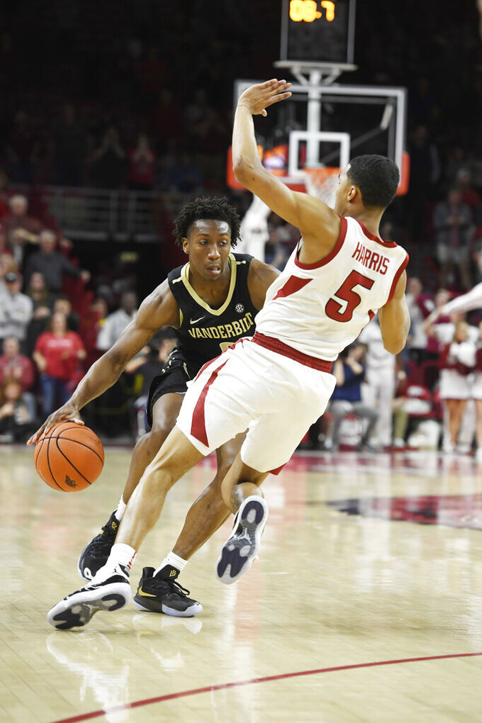 Vanderbilt guard Saben Lee (0) is called with an offensive foul as he tries to drive past Arkansas defender Jalen Harris (5) during the second half of an NCAA college basketball game, Tuesday, Feb. 5, 2019 in Fayetteville, Ark. (AP Photo/Michael Woods)