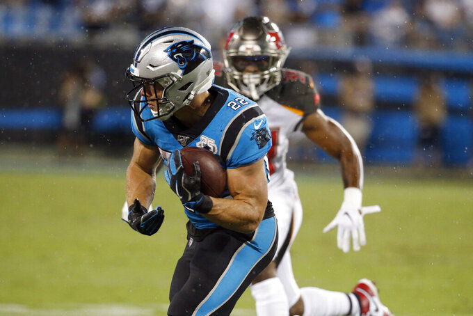 Carolina Panthers running back Christian McCaffrey (22) runs against the Tampa Bay Buccaneers during the first half of an NFL football game in Charlotte, N.C., Thursday, Sept. 12, 2019. (AP Photo/Brian Blanco)