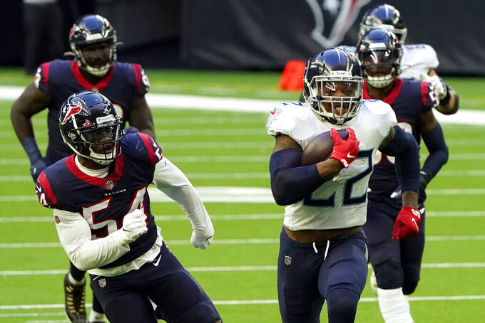 FILE - In this Sunday, Jan. 3, 2021, file photo, Tennessee Titans running back Derrick Henry (22) runs for a touchdown as Houston Texans' Jacob Martin (54)  chases  during the first half of an NFL football game in Houston. The Titans play the Baltimore Ravens in a wild-card playoff game on Sunday.  (AP Photo/Eric Christian Smith, File)