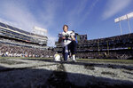 FILE - In this Oct. 12, 2016, file photo, San Diego Chargers quarterback Philip Rivers (17) kneels after an NFL football game against the Oakland Raiders in Oakland, Calif. From his first career start in 2006 to some riveting comebacks and crushing defeats, Chargers quarterback Philip Rivers has had plenty of memorable experiences playing against the Raiders at the Oakland Coliseum. So there will be a bit of nostalgia when Rivers plays his final scheduled game there Thursday night, Nov. 7, 2019,  when the Chargers (4-5) take on the Raiders (4-4) in a game crucial for both teams' playoff hopes. (AP Photo/Marcio Jose Sanchez, File)