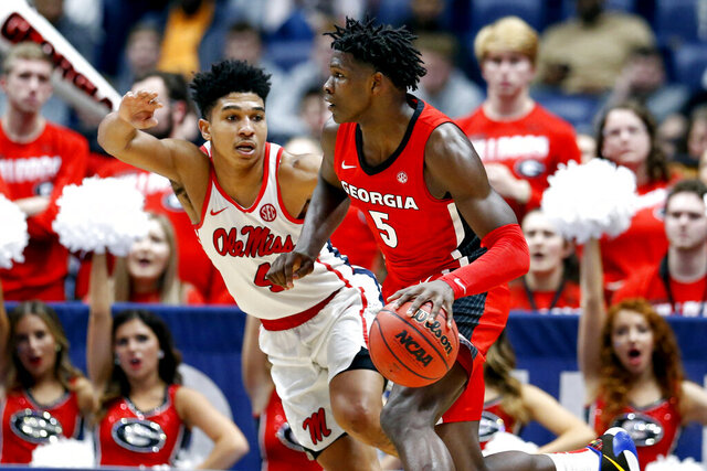 FILE - In this March 11, 2020, file photo, Georgia guard Anthony Edwards (5) drives against Mississippi's Breein Tyree (4) in the second half of an NCAA college basketball game in the Southeastern Conference Tournament in Nashville, Tenn. Edwards is expected to be a contender for the No. 1 draft pick in the NBA draft lottery Thursday, Aug. 20, 2020. (AP Photo/Mark Humphrey, File)
