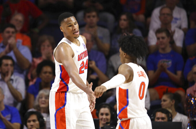 Florida forward Kerry Blackshear Jr. (24) celebrates with guard Ques Glover against North Florida during the second half of an NCAA college basketball game Tuesday, Nov. 5, 2019, in Gainesville, Fla. (AP Photo/Matt Stamey)