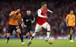 Arsenal's Mesut Ozil in action during the English Premier League soccer match against Wolverhampton Wanderers at The Emirates Stadium, London, Saturday Nov. 2, 2019. (Paul Harding/PA via AP)