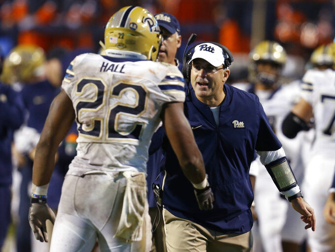 Pittsburgh coach Pat Narduzzi, right, welcomes running back Darrin Hall (22) back to the sideline after a touchdown during the second half of an NCAA college football game against Virginia in Charlottesville, Va., Friday, Nov. 2, 2018. (AP Photo/Steve Helber)