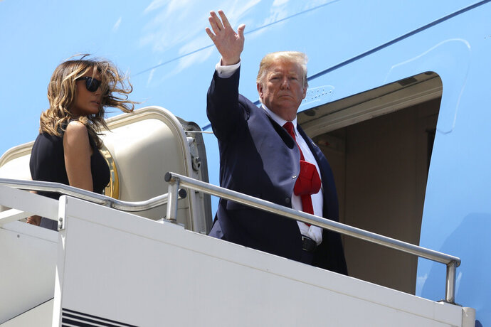 President Donald Trump and first lady Melania Trump board Air Force One at Wright-Patterson Air Force Base after meeting with people affected by the mass shooting in Dayton, Ohio, Wednesday, Aug. 7, 2019, at Wright-Patterson Air Force Base, Ohio. (AP Photo/Evan Vucci)