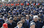 Participants pay a silent tribute during a ceremony to commemorate South Korean soldiers killed in three major clashes with North Korea in the West Sea, in Seoul, South Korea, Friday, March 22, 2019. The South Korean government has designated the fourth Friday of March as the commemoration day for the fallen soldiers in the clashes, including the North's torpedoing of the South Korean Navy corvette Cheonan in 2010, which killed 46 sailors. (AP Photo/Ahn Young-joon)