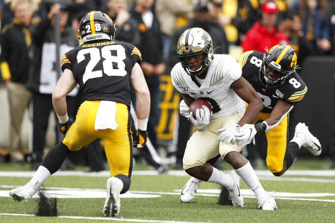 No. 23 Iowa holds off Purdue 26-20