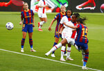 PSG's Marie-Antoinette Katoto, second right, scores her team's first goal during the Women's Champions League semifinal second leg soccer match between FC Barcelona and Paris Saint- Germain at the Johan Cruyff stadium in Barcelona, Spain, Sunday, May. 2, 2021. (AP Photo/Joan Monfort)