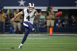 FILE - In this Dec. 15, 2019, file photo, Los Angeles Rams kicker Greg Zuerlein (4) kicks during an NFL football game against the Dallas Cowboys in Arlington, Texas. A person with knowledge of the deal says the Dallas Cowboys and kicker Greg Zuerlein have agreed on a $7.5 million, three-year contract. The Cowboys are set for a kicking competition because they also re-signed Kai Forbath after he made all 10 field goals last season as the replacement for a shaky Brett Maher. (AP Photo/Michael Ainsworth, File)