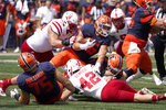 Illinois running back Mike Epstein carries the balls and is tackled by Nebraska defensive lineman Ty Robinson during the first half of an NCAA college football game Saturday, Aug. 28, 2021, in Champaign, Ill. (AP Photo/Charles Rex Arbogast)
