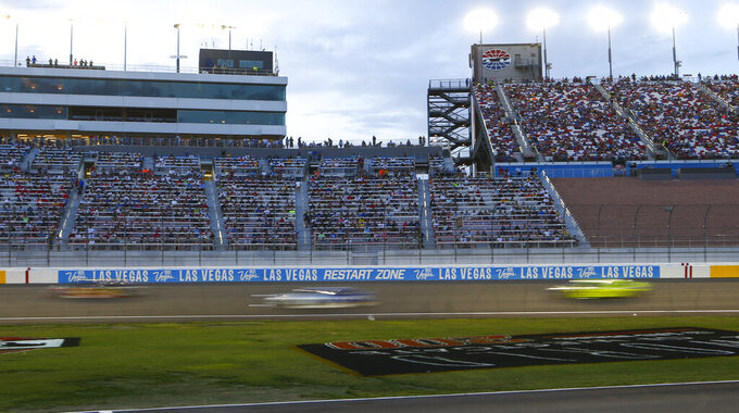 Cars round the track during a NASCAR Cup Series auto race at the Las Vegas Motor Speedway on Sunday, Sept. 15, 2019. (AP Photo/Chase Stevens)