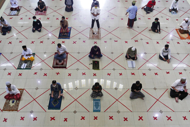 Muslims pray spaced apart to help curb the spread of the coronavirus during a Friday prayer at the Al Barkah Grand Mosque in Bekasi on the outskirts of Jakarta, Indonesia, Friday, May 29, 2020. Muslims in some parts of Indonesia attended Friday prayers as mosques closed by the coronavirus for weeks were allowed to start reopening in the world's most populous Muslim nation. (AP Photo/Achmad Ibrahim)