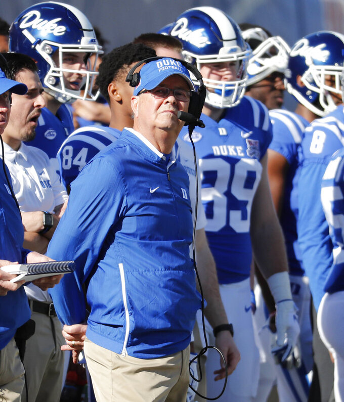 Duke head coach David Cutcliffe looks toward the scoreboard during the first half of the Independence Bowl, an NCAA college football game against Temple, in Shreveport, La., Thursday, Dec. 27, 2018. (AP Photo/Rogelio V. Solis)