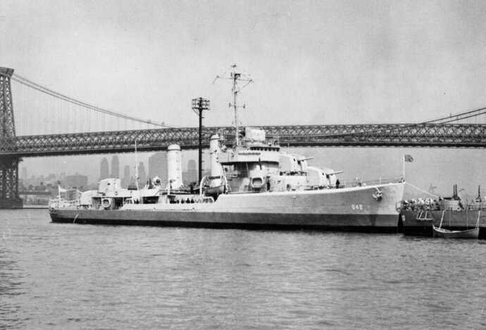 FILE - This undated file photo provided by the U.S. Navy shows the USS Turner on the East River in New York City near the Williamsburg Bridge. The USS Turner exploded and sank in 1944. American Legion officials are calling on New York lawmakers to request the Pentagon exhume the Long Island graves of sailors killed in the World War II ship explosion in an attempt to identify the fallen servicemen. (U.S. Navy via AP, File)