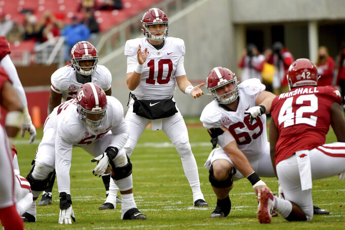 Alabama quarterback Mac Jones (10) gets ready to run a play against Arkansas during an NCAA college football game Saturday, Dec. 12, 2020, in Fayetteville, Ark. (AP Photo/Michael Woods)