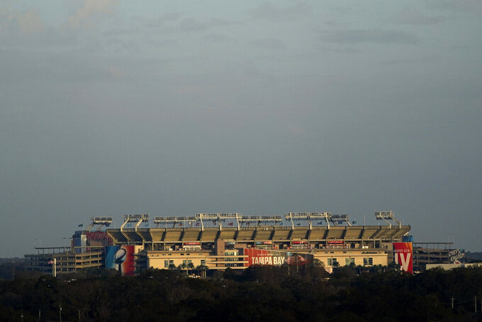 Raymond James Stadium rises in the distance ahead of Super Bowl 55 Saturday, Feb. 6, 2021, in Tampa, Fla. The venue is hosting Sunday's Super Bowl football game between the Tampa Bay Buccaneers and the Kansas City Chiefs. (AP Photo/Charlie Riedel)