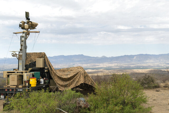 In this April 4, 2019 photo, provided by the U.S. Army, a mobile surveillance camera system manned by soldiers monitors a sector near the Presidio Border Patrol Station at Presidio, Texas. The Trump administration has been quietly adding military surveillance cameras at the U.S.-Mexico border in response to the novel coronavirus pandemic despite the fact fewer people appear to be crossing illegally. Documents obtained by The Associated Press show the Department of Defense at the request of the Department of Homeland Security sent 60 mobile surveillance cameras in addition to 540 more troops to the southwest border this month. (Sgt. Brandon Banzhaf/U.S. Army via AP)