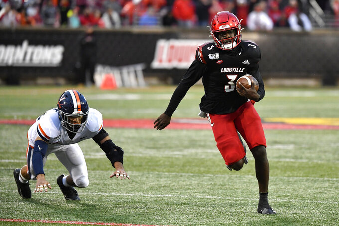 Virginia safety Joey Blount (29) attempts to tackle Louisville quarterback Micale Cunningham (3) during the second half of an NCAA college football game in Louisville, Ky., Saturday, Oct. 26, 2019. Louisville won 28-21. (AP Photo/Timothy D. Easley)