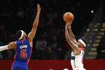 Washington Wizards guard Isaiah Thomas (4) shoots against Detroit Pistons guard Bruce Brown (6) during the first half of an NBA basketball game, Monday, Nov. 4, 2019, in Washington. (AP Photo/Nick Wass)