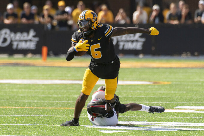 Missouri wide receiver Keke Chism, top, is tackled by Southeast Missouri State's Trai Hodges, bottom, during the first quarter of an NCAA college football game Saturday, Sept. 18, 2021, in Columbia, Mo. (AP Photo/L.G. Patterson)