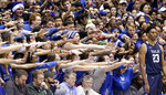 FILE - In this Dec. 8, 2018, file photo, Duke fans cheer as Yale's Jordan Bruner (23) waits to inbound the ball during the first half of an NCAA college basketball game in Durham, N.C. As lock-downs are lifted, restrictions on social gatherings eased and life begins to resemble some sense, sports are finally starting to emerge from the coronavirus pandemic. Many sports business experts believe those hardy fans will be the first to return. (AP Photo/Gerry Broome, File)