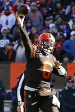 Cleveland Browns quarterback Baker Mayfield throws a 1-yard touchdown pass to tight end Demetrius Harris (88) during the first half of an NFL football game against the Baltimore Ravens, Sunday, Dec. 22, 2019, in Cleveland. (AP Photo/Ron Schwane)