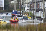 """A member of the public is rescued after flooding in Nantgarw, Wales, Sunday, Feb. 16, 2020. Storm Dennis roared across Britain on Sunday, lashing towns and cities with high winds and dumping so much rain that authorities urged residents to protect themselves from """"life-threatening floods"""