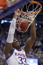 Kansas forward David McCormack dunks during the first half of an NCAA college basketball game against Texas Tech in Lawrence, Kan., Saturday, Feb. 1, 2020. (AP Photo/Orlin Wagner)