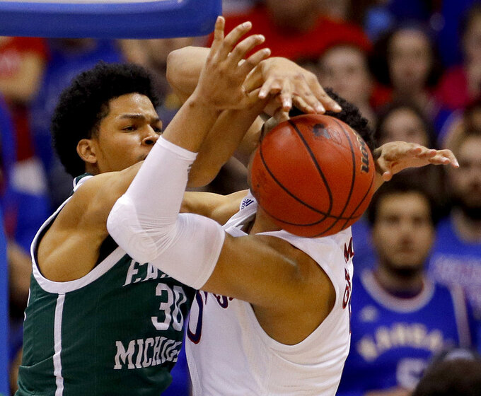 Eastern Michigan's Jalen King (30) tries to steal the ball from Kansas' Quentin Grimes during the second half of an NCAA college basketball game Saturday, Dec. 29, 2018, in Lawrence, Kan. Kansas won 87-63. (AP Photo/Charlie Riedel)