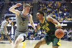 Baylor guard MaCio Teague (31) defends against West Virginia guard Sean McNeil (22) during the first half of an NCAA college basketball game Saturday, March 7, 2020, in Morgantown, W.Va. (AP Photo/Kathleen Batten)