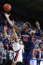 Pepperdine forward Kameron Edwards (20) and Gonzaga guard Ryan Woolridge (4) go after a rebound during the first half of an NCAA college basketball game in Spokane, Wash., Saturday, Jan. 4, 2020. (AP Photo/Young Kwak)