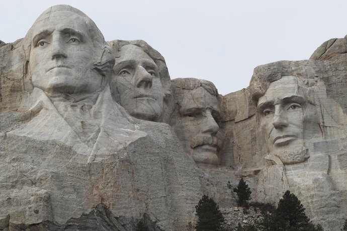 FILE - In this Dec. 9, 2016, file photo, the faces of the presidents that make up the Mount Rushmore monument are shown near Keystone, S.D. The PBS host Geoffrey Baer is back this summer with new episodes of his series
