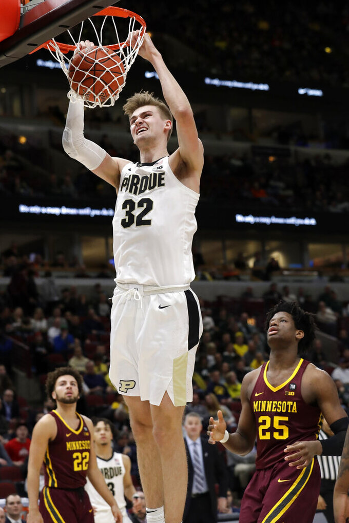 Purdue's Matt Haarms (32) dunks during the second half of an NCAA college basketball game against Purdue in the quarterfinals of the Big Ten Conference tournament, Friday, March 15, 2019, in Chicago. (AP Photo/Nam Y. Huh)