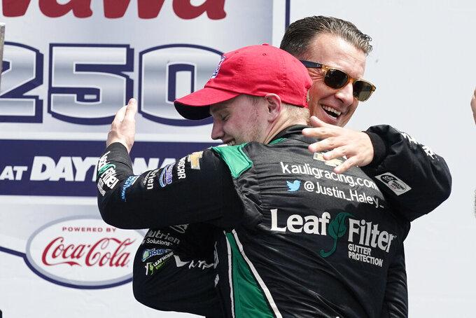 NASCAR Xfinity Series auto race winner Justin Haley, left, is congratulated by AJ Allmendinger at Daytona International Speedway, Saturday, Aug. 28, 2021, in Daytona Beach, Fla. Allmendinger finished second in a close race. (AP Photo/John Raoux)