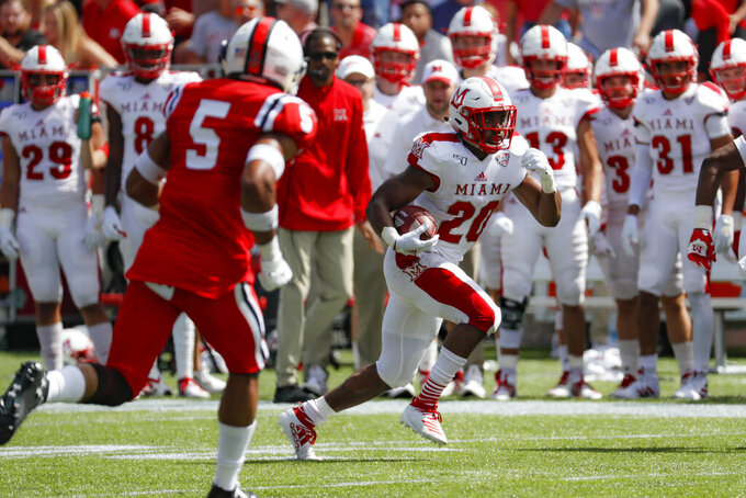 Miami of Ohio running back Tyre Shelton (20) runs the ball in the first half of an NCAA college football game against Cincinnati, Saturday, Sept. 14, 2019, in Cincinnati. (AP Photo/John Minchillo)