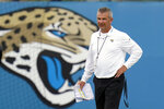 FILE - Jacksonville Jaguars head coach Urban Meyer watches players perform drills during an NFL football practice in Jacksonville, Fla., in this Monday, June 14, 2021, file photo. The Jacksonville Jaguars said Wednesday, July 14, 2021,  that coach Urban Meyer and general manager Trent Baalke were subpoenaed as part of a lawsuit filed by lawyers for Black players suing former Iowa strength coach Chris Doyle for discrimination. (AP Photo/John Raoux, File)