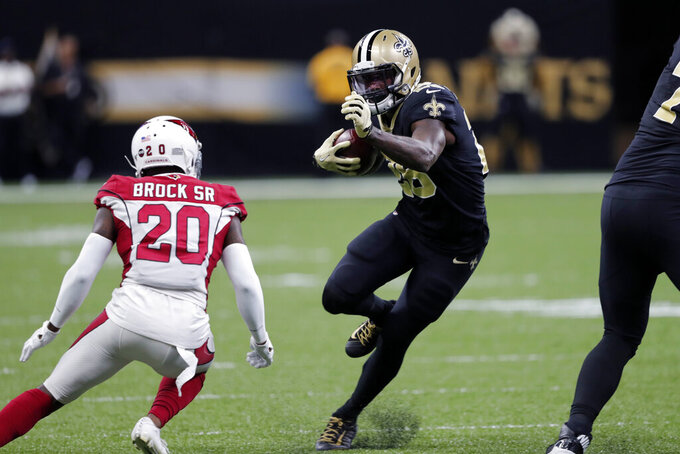 New Orleans Saints running back Latavius Murray (28) carries against Arizona Cardinals defensive back Tramaine Brock (20) in the first half of an NFL football game in New Orleans, Sunday, Oct. 27, 2019. (AP Photo/Bill Feig)