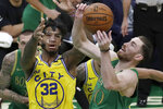 Boston Celtics forward Gordon Hayward, right, drives against Golden State Warriors forward Marquese Chriss (32) during the first quarter of an NBA basketball game Thursday, Jan. 30, 2020, in Boston. (AP Photo/Elise Amendola)