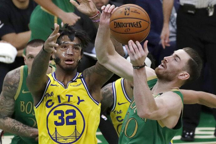 Boston Celtics forward Gordon Hayward, right, drives against Golden State Warriors forward Marquese Chriss (32) during the first quarter of an NBA basketball game Thursday, Jan. 30, 2020, in Boston. (AP Photo/Elise Amendola)