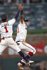 Atlanta Braves second baseman Ozzie Albies (1) and outfielder Ronald Acuna Jr. celebrate after the Braves defeated the New York Mets 5-3 in a baseball game Tuesday, Aug. 13, 2019, in Atlanta. (AP Photo/John Bazemore)