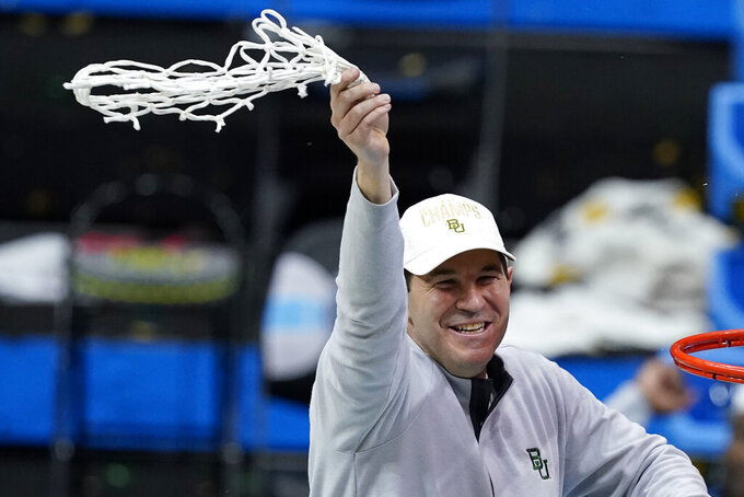 Baylor head coach Scott Drew celebrates after cutting down the net after the championship game against Gonzaga in the men's Final Four NCAA college basketball tournament, Monday, April 5, 2021, at Lucas Oil Stadium in Indianapolis. Baylor won 86-70. (AP Photo/Darron Cummings)