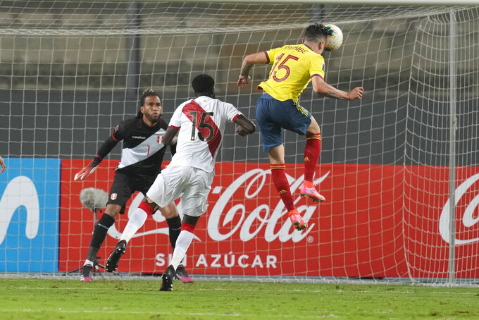 Colombia's Matheus Uribe scores his side's second goal against Peru during a qualifying soccer match for the FIFA World Cup Qatar 2022 at the National stadium in Lima, Peru, Thursday, June 3, 2021. (AP Photo/Martin Mejia)