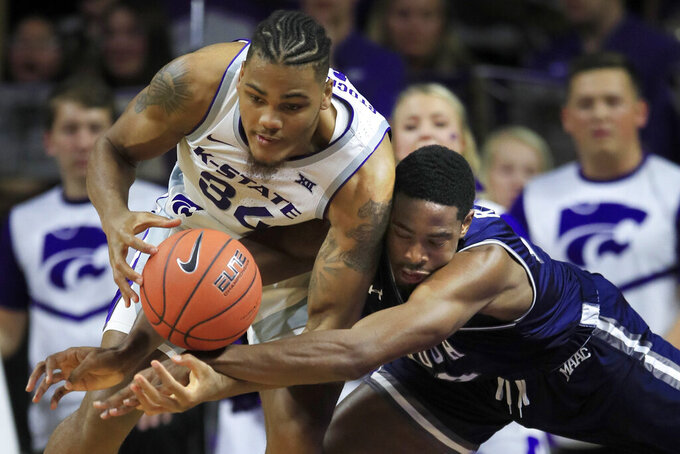 Monmouth forward Nikkei Rutty, right, and Kansas State forward Levi Stockard III (34) compete for the ball during the first half of an NCAA college basketball game in Manhattan, Kan., Wednesday, Nov. 13, 2019. (AP Photo/Orlin Wagner)
