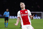 FILE - In this Tuesday, Dec. 10, 2019 file photo, Ajax's Donny van de Beek reacts as a pass for him went out during the group H Champions League soccer match between Ajax and Valencia at the Johan Cruyff ArenA in Amsterdam, Netherlands. Premier League clubs have been busy in the transfer market in an unusually short offseason because of pandemic-induced late finish to last season. Donny Van de Beek will strengthen the squad of Manchester United. (AP Photo/Peter Dejong, File)