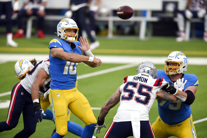 Los Angeles Chargers quarterback Justin Herbert throws against the New England Patriots during the first half of an NFL football game Sunday, Dec. 6, 2020, in Inglewood, Calif. (AP Photo/Kelvin Kuo)
