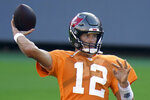 FILE - In this Aug. 28, 2020, file photo, Tampa Bay Buccaneers quarterback Tom Brady (12) throws a pass during an NFL football training camp practice in Tampa, Fla. In the first matchup of 40-plus quarterbacks in NFL annals, during one of the most anticipated openers the league has seen _ though it won't be seen by fans at Raymond James Stadium due to the coronavirus pandemic _  Brady makes his Buccaneers debut against that youngster Drew Brees and the Saints. (AP Photo/Chris O'Meara, File)